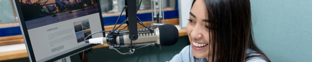 young professional talking on radio microphone